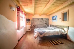 Letto o letti in una camera di Alpe Rebelle