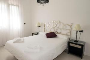Cama o camas de una habitación en Parques Casablanca