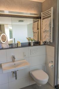 Ein Badezimmer in der Unterkunft Zeitlers Hotel & Apartments