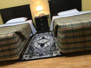 Cama ou camas em um quarto em Al Musafer Hotel Riyadh