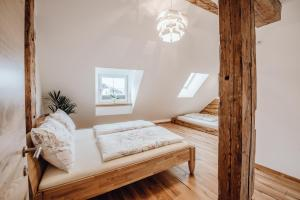 Postel nebo postele na pokoji v ubytování Apartment Altstadtflair