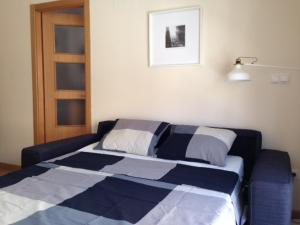 A bed or beds in a room at Quiet, Modern Apartment