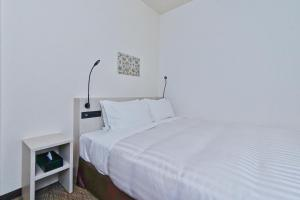 A bed or beds in a room at Best Western Osaka-tsukamoto