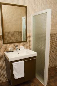 A bathroom at Sheva Hotel