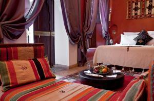 Ein Bett oder Betten in einem Zimmer der Unterkunft Riad Zolah