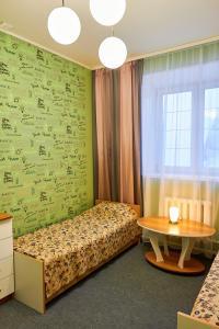 Кровать или кровати в номере Гостевой Дом Пурга