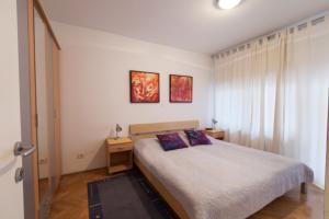 A bed or beds in a room at Apartment Irena