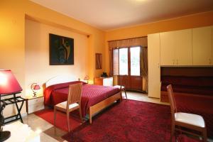Letto o letti in una camera di B&B Villa Casablanca