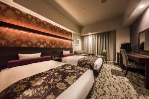 A bed or beds in a room at Hotel WBF Sapporo Chuo