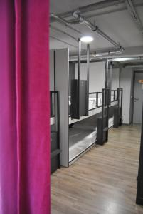 A bunk bed or bunk beds in a room at Quartier Bilbao Hostel