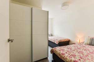 A bed or beds in a room at Luxury Family Residence Schinkeldijkje