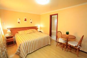 A bed or beds in a room at Hotel Cabanas Alto Da Serra