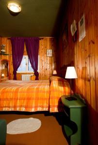 Letto o letti in una camera di Hotel La Lucciola