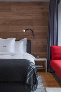 A bed or beds in a room at ION City Hotel
