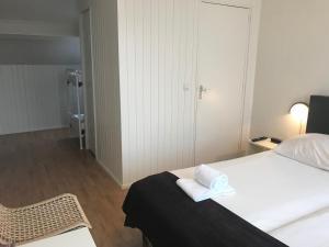 Un ou plusieurs lits dans un hébergement de l'établissement Hotel Valkenhof