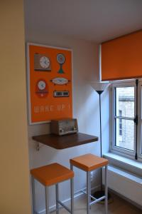 A television and/or entertainment center at Duplex Appartment Bruges Centre