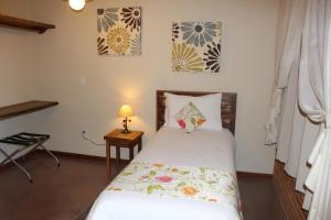 A bed or beds in a room at Pousada Villa dos Leais