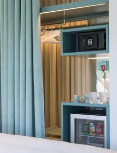 A television and/or entertainment center at WC by The Beautique Hotels