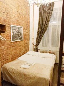 Кровать или кровати в номере Отель Антре