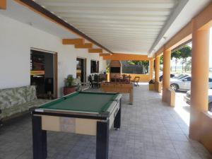 A pool table at Hotel Dom Bosco Itanhaém