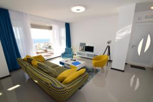 Zona de estar de 87 Stairs Apartments