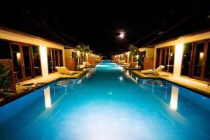 The swimming pool at or near Luce d'Alma Suites Resort & Spa