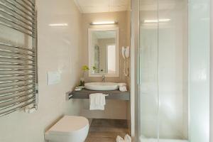 A bathroom at Demetra Hotel