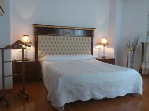 Cama o camas de una habitación en Hotel Cardinal