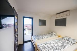 A bed or beds in a room at Vila Cluj Boutique