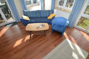 Ein Sitzbereich in der Unterkunft Villa Seerose - Appartement 09