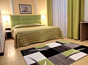A bed or beds in a room at Moonlight Hotel&Suites