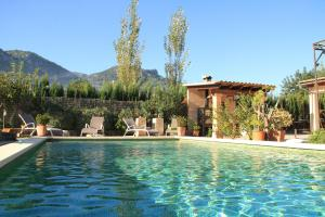 The swimming pool at or near Can Toniet