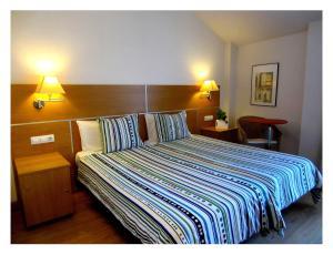 Un ou plusieurs lits dans un hébergement de l'établissement Hotel Rural Latxanea