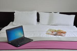 Кровать или кровати в номере Hotel Dolynskiy