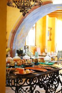 A restaurant or other place to eat at Hotel de Charme Capela das Artes