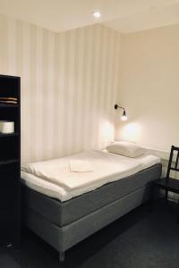 Säng eller sängar i ett rum på Stockholm Hostel