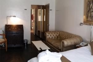 Ein Sitzbereich in der Unterkunft Hotel Approach