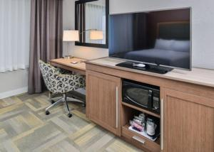 A television and/or entertainment center at Hampton Inn and Suites Altoona-Des Moines by Hilton