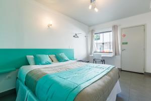 A bed or beds in a room at Concept Design Hostel & Suites