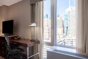 A television and/or entertainment center at Hilton Garden Inn West 35th Street