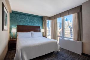 A bed or beds in a room at Hilton Garden Inn West 35th Street