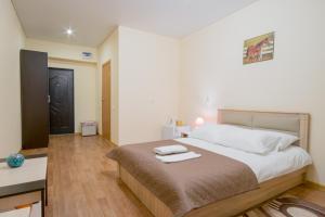 Кровать или кровати в номере Отель Мандарин