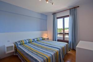 A bed or beds in a room at Apartamentos Cristina