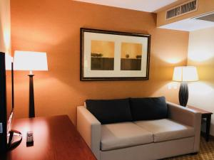 A seating area at Queens County Inn and Suites