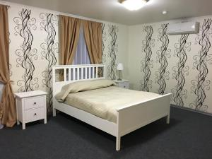 A bed or beds in a room at Gostinitsa DmitrovGrad