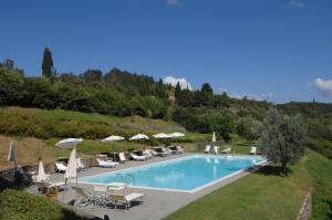 The swimming pool at or near Castello Di Gargonza