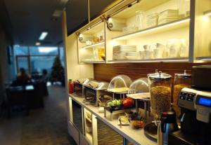 Un restaurant u otro lugar para comer en Smilčių Boutique Hotel, Tubinas Hotels