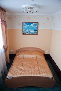 Кровать или кровати в номере Гостиничный Компелкс Ельцовский
