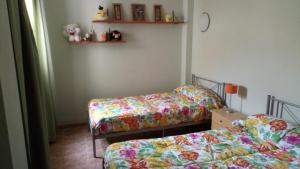Cama o camas de una habitación en Duplex Alcalde Juan Evora