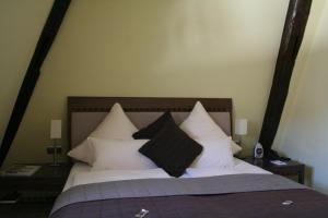 Ein Bett oder Betten in einem Zimmer der Unterkunft Hotel Merian